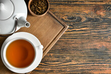Composition With Cup Of Tasty Hojicha Green Tea On Wooden Background