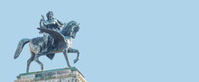 Banner With Statue Of Greek Goddess Muse Riding Winged Horse Pegasus In Historical, Touristic Downtown In Vienna Austria At Blue Sky Background And Copy Space. Concept Of Cultural Heritage And Travel.