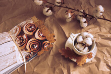 Coffee Roll In Autumn Style With Leaves