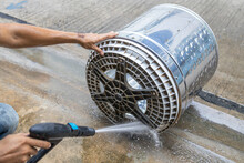Dirty Washing Machine Tub With High-pressure Washer,rinsing The Laundry Tub,remove Dirt Stuck,mold,algae Stains,maintaining Hygienic Cleaning Of Household Electrical Appliance,cleanliness Concept