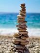 canvas print picture - Turm aus Steinchen am Kiesstrand der Kroatischen Adria
