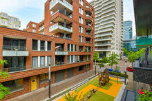 Road Between Modern Residential House Facades In City