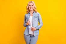 Photo Of Attractive Positive Old Woman Hands Denim Jeans Shirt Smile Enjoy Isolated On Yellow Color Background