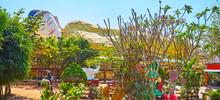 Reclining Buddha Through The Garden's Greenery, Mya Tha Lyaung Buddha Temple, Bago, Myanmar