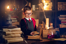 Small Wizard Reads Magic Book Cosplay Harry Potter. Halloween Holiday. Halloween Costume Party