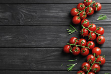 Composition Of Fresh Ripe Branches Of Cherry Tomatoes, Thyme, Basil, Rosemary, Spices On A Wooden Textured Background
