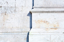 Base Of The Marble Columns With White Stone Frame Of A Romanesque Italian Church