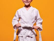 Boy Tightening Kimono Belt Knot