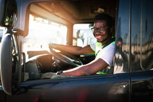 Young Handsome African American Man Working In Towing Service And Driving His Truck.