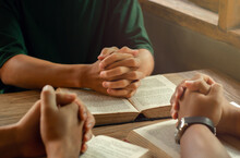 Christians Join A Group Of Cells That Come Together To Pray And Seek The Blessings Of God. With Bible And Share The Gospel With Copy Space Near The Window Sill In The Morning