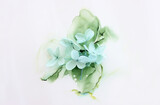 Creative image of pastel mint Hydrangea flowers on artistic ink background. Top view with copy space