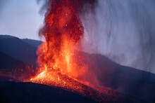 Volcano Eruption In Evening In Mountains