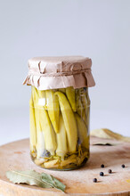 Homemade Pickled Okra In A Glass Jar On A Gray Background. Preservation Of Vegetables. Close-up