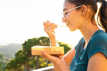 Crop Woman Enjoying Delicious Waffles Against Mountains In Sunshine
