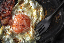 Delicious Fried Egg And Bacon Strips With Spices
