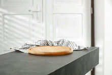 A Stone Minimalist Table With A Blank And Christmas Accessories On A Background Of White Doors With A Shadow