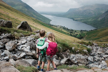 Siblings Hugging Taking In The Beautiful View Over Scafell Pike