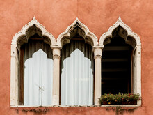 A Typical Three-mullioned Window (or Three-light Window) Of A Building, On A Red Wall, In A Street Of Venice, Veneto Region, Italy, Europe