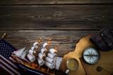 Fototapeta Kawa jest smaczna - Columbus Day. Vintage discovery equipment with copy space on dark wooden background.