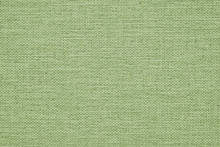 Close-up Of Pale Green Woven Surface. It Looks Like The Texture Of Linen. Abstract Light Background From Fabric. Textured Braided Elegant Tint Backdrop. Macro