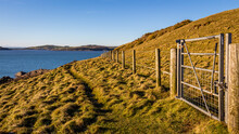 A Gate And A Rugged Coastal Trail Along The Solway Firth On A Sunny Winters Day