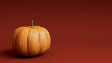 Pumpkin On A Burnt Orange Colored Background. Fall Themed Image With Copy-space.