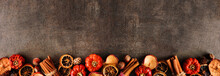 Autumn Baking Spices And Ingredients. Bottom Border On A Dark Stone Banner Background With Copy Space. Top Down View.