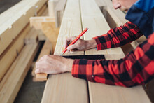 Hands Of A Carpenter Using A Right Angle Tool Or Square