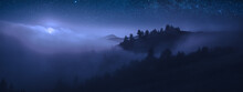 Beautiful Moonrise Over The Foggy Mountains At Night