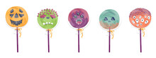 Halloween Collection Of Candy On A Stick In The Form Of Monsters. Round Lollipops In A Transparent Package.