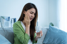 Asian Beautiful Woman Feel Terrible Toothache After Drink Cold Water.