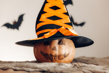 Pumpkin With Painted Face And Witch Hat. Halloween Concept.