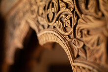 Fragment Of An Arch Made Of Wood With Carvings In The Form Of An Ornament In The Indian Style.