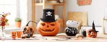 Classic Carven Spooky Jack-o-lantern In Pirate Hat Standing On Wooden Table