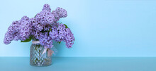 A Bouquet Of Lilac Flowers With A Ribbonon A Pink Background. A Holiday Card. Floral Background.I Congratulate You On The Holiday. Mother's Day, Teacher's Day, March 8. Banner. Copy Space.