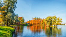 Bright Autumn Landscape With State Museum Reserve Gatchina. Sunny Panoramic Autumn View Of The Park, Blue Lake And Great Palace In The Shore.