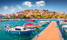 Sunny Summer  View Of Astros Port. Wonderful Morning Seascape Of Myrtoan Sea. Picturesque Urban Scene Of Arcadia Region, Greece, Europe. Traveling Concept Background.