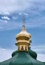 Golden Green Domes Of The Church On A Background Of Sky.