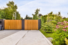 Exterior Of Modern Minimalist Villa With Wooden And Metal Fence