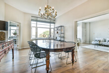 Wooden Dining Table With Chairs In Apartment
