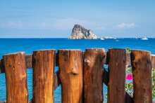 Panarea Island (Aeolian Archipelago), Lipari, Messina, Sicily, Italy: View Of The Rock Of Dattilo With A Wooden Fence In The Foreground.