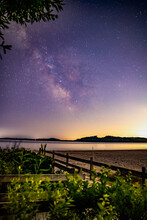 Milky Way Galaxy Shining In The Night Sky Above The Ocean.