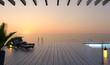 canvas print picture - Sonnenterrasse mit Sonnenliegen bei Sonnenuntergang