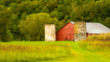 Red Barn With Two Silos.
