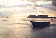Beautiful Beach With Fisherman Boat During Sunset At Samara, Costa Rica.