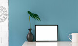 Fototapeta Kawa jest smaczna - Mockup blank white screen tablet and decoration object on white top table and light blue wall.