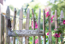 Wooden Sign And Old Key Ring Hanging On Rustic Fence