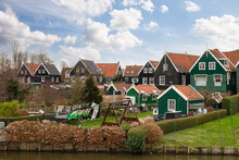 Small Fishing Village On The Former Island Of Marken With Typical Wooden Fishermen's Houses.