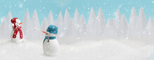 Happy Snowmen Playing Snowballs In Winter Christmas Landscape. Merry Christmas And Happy New Year Celebration