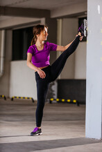 Young Runner Fit Woman Streching Before Exercises Outdoors. Athletic Female Strech After Workout Outside. Sport And People Concept.